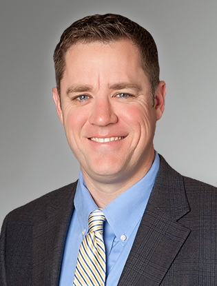Headshot of Tim White, Senior Vice President at Buxton